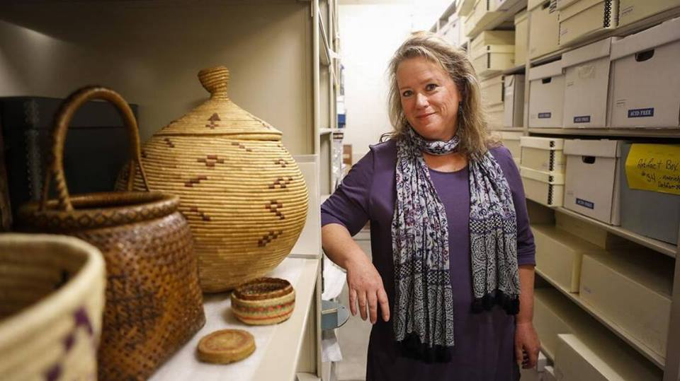 woman posing with artifacts