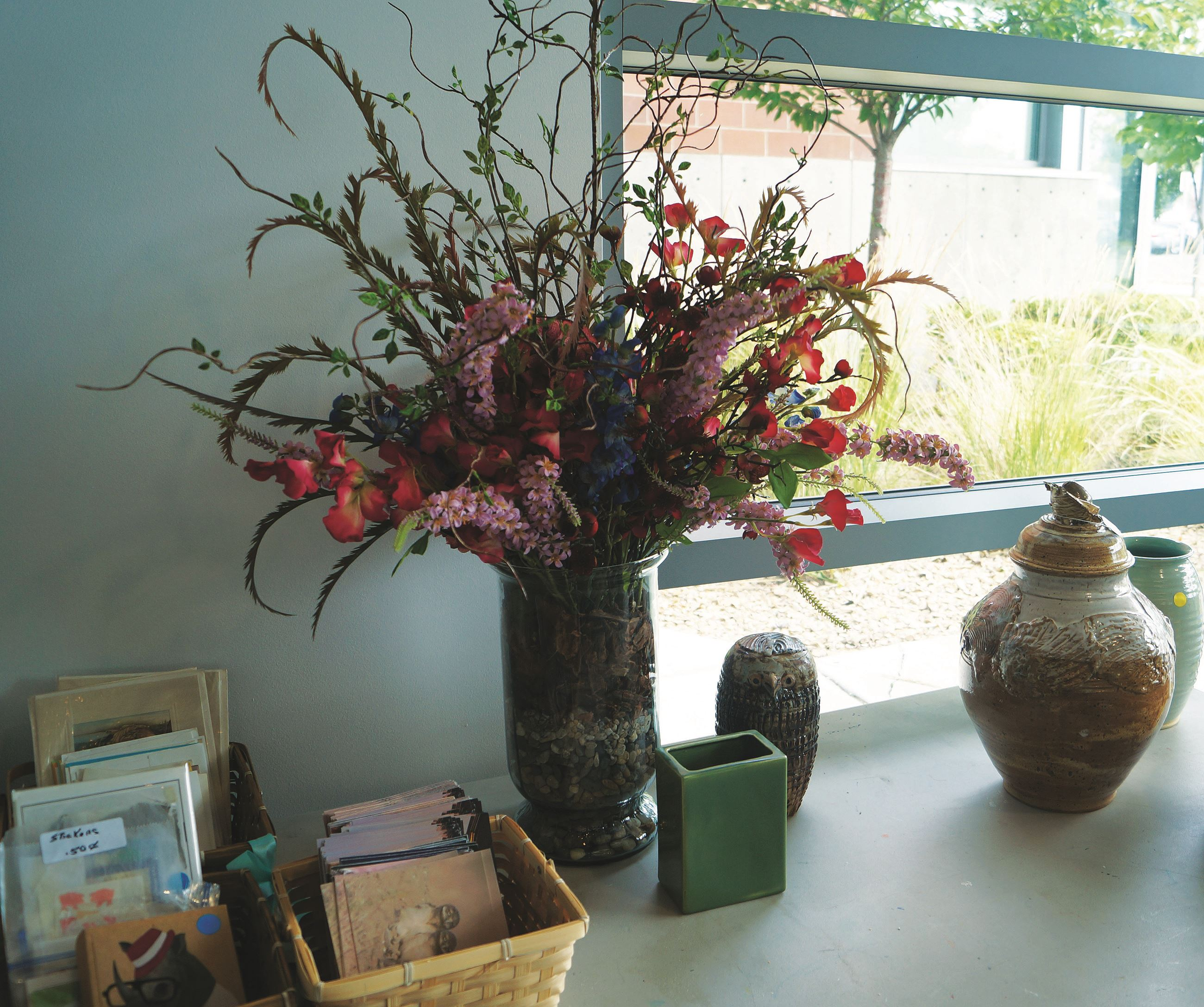 Floral display, vase, postcards
