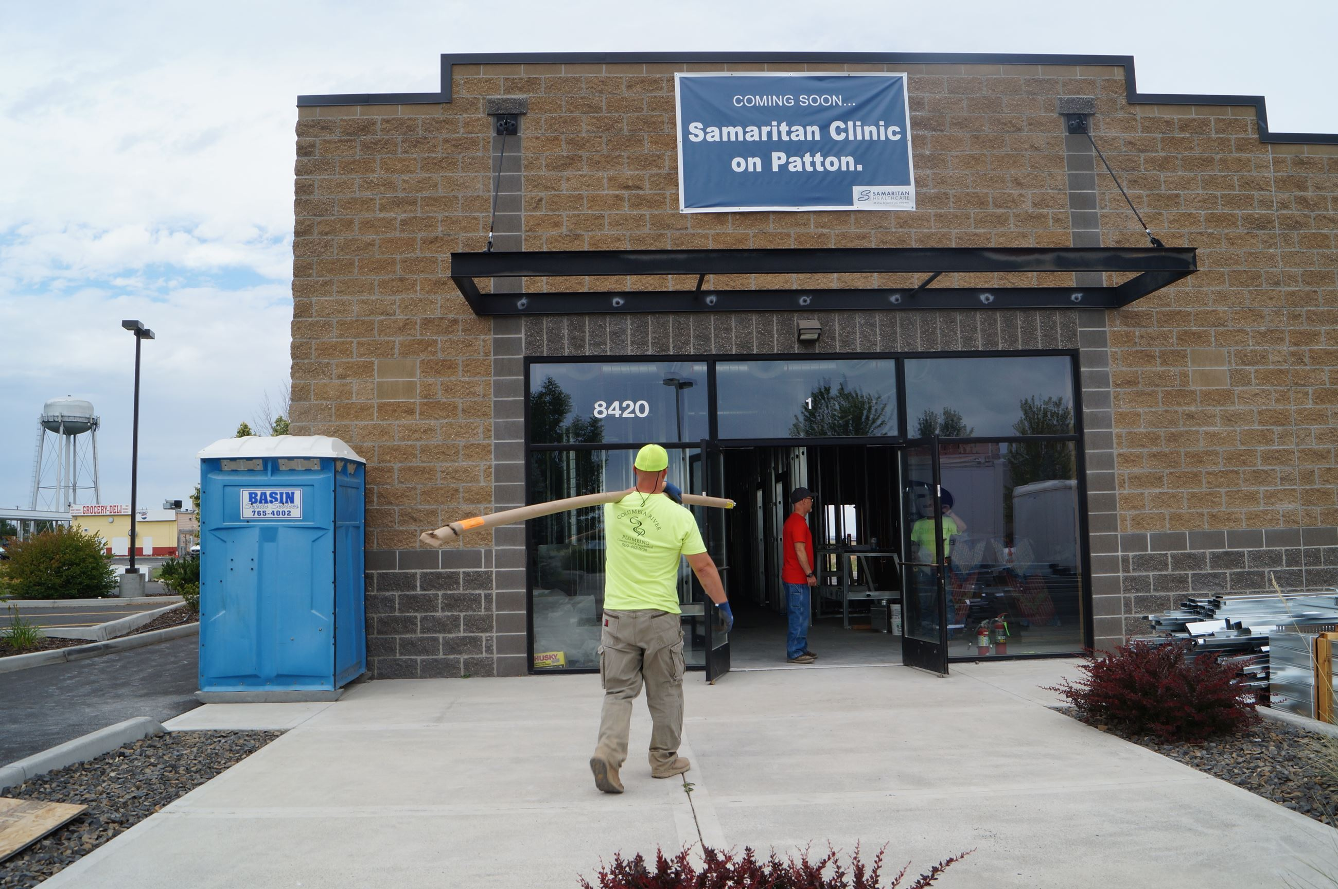 A worker carries material inside Samaritan's Clinic on Patton in Moses Lake.