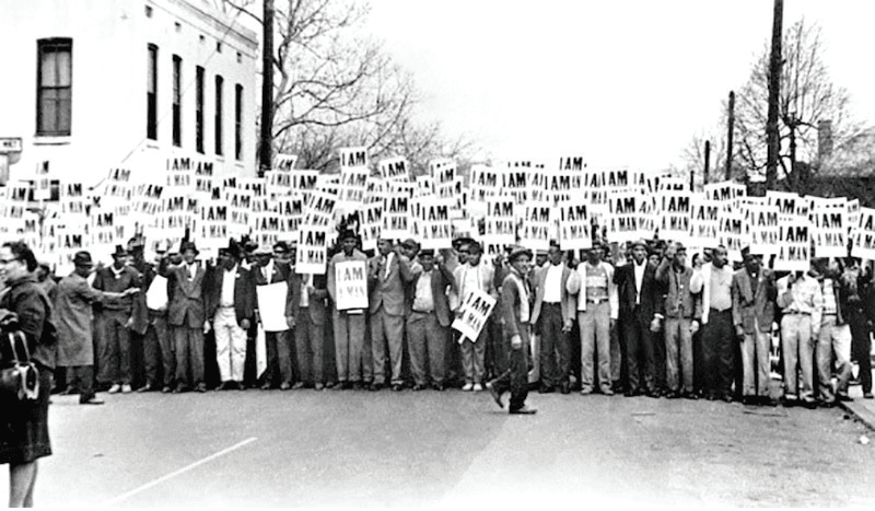 large group of people protesting in the civil rights era