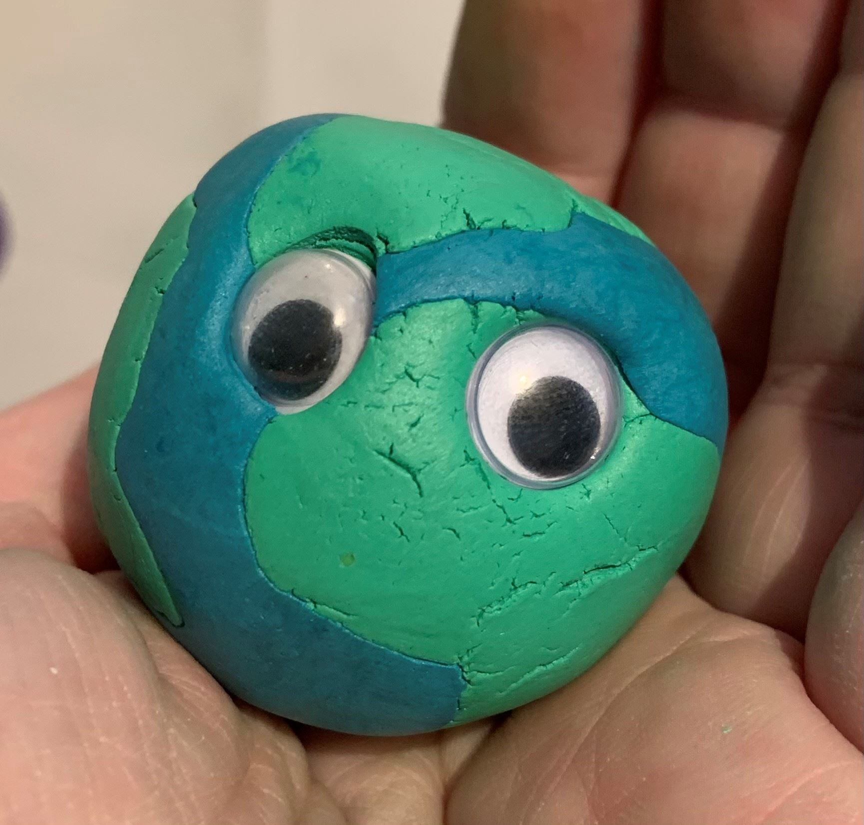 clay sculpture of the earth, golf-ball sized