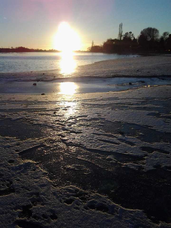 sun shining on lake ice