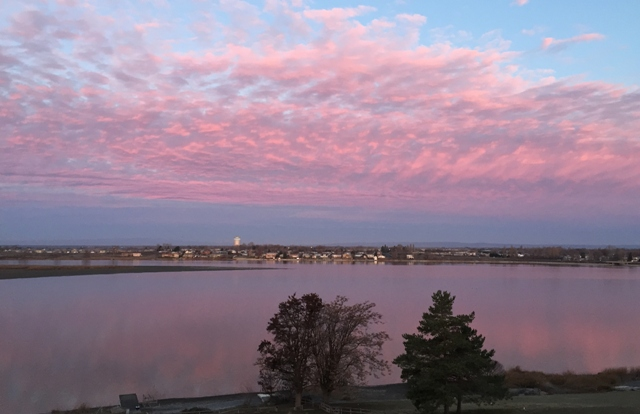 pink clouds over lake