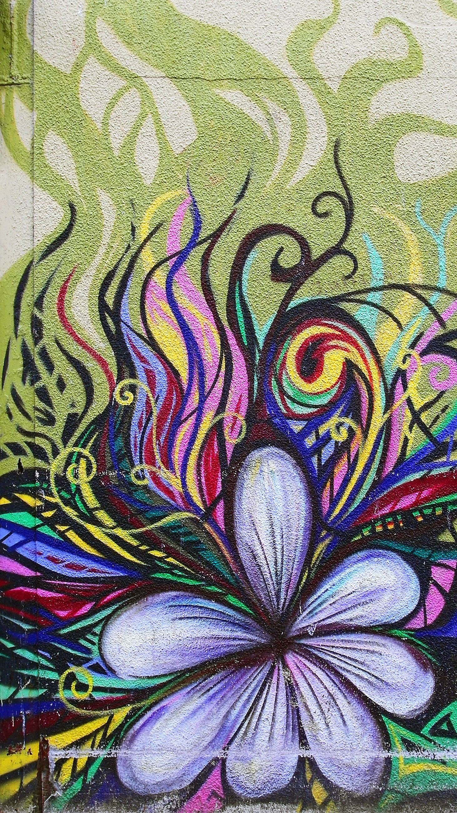 painting of purple flower with yellow, pink, and green accents