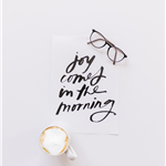 black framed eyeglasses, coffee, black calligraphy lettering