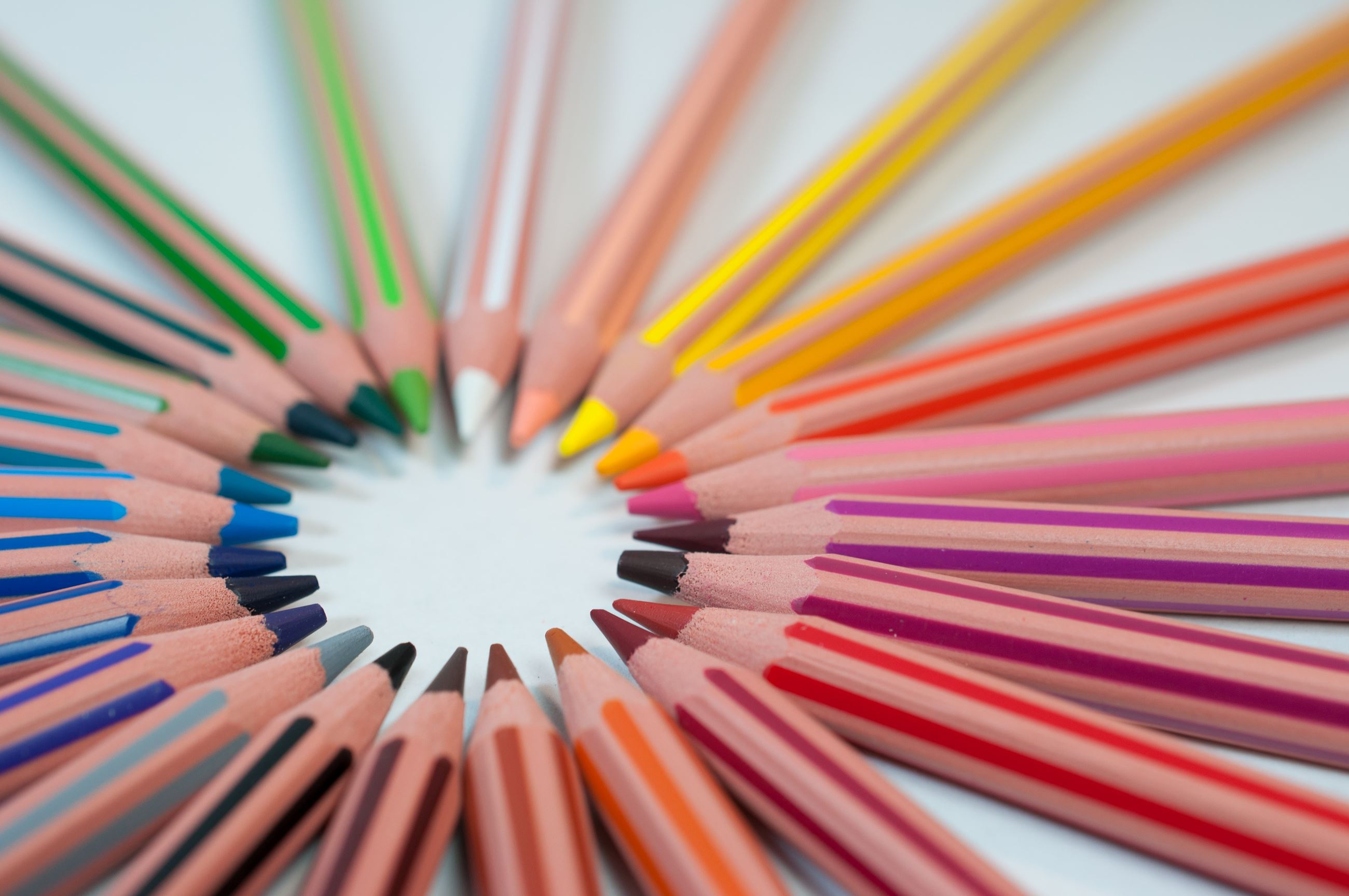 colored pencils lay out in a circle formation