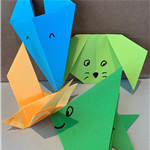 paper folded into different, simple shapes